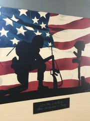 A mural at Ramsey High School honors those who died in service to their country.