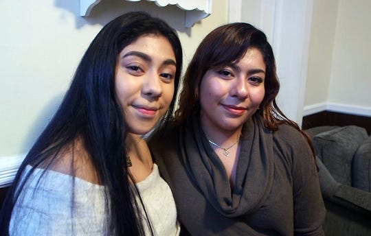 Sisters Fatima, left, and Deysi Perez Avila, right, are photographed in their home in Red Bank, NJ. Deysi, 22, is a DACA recipient while Fatima, 17, is not.