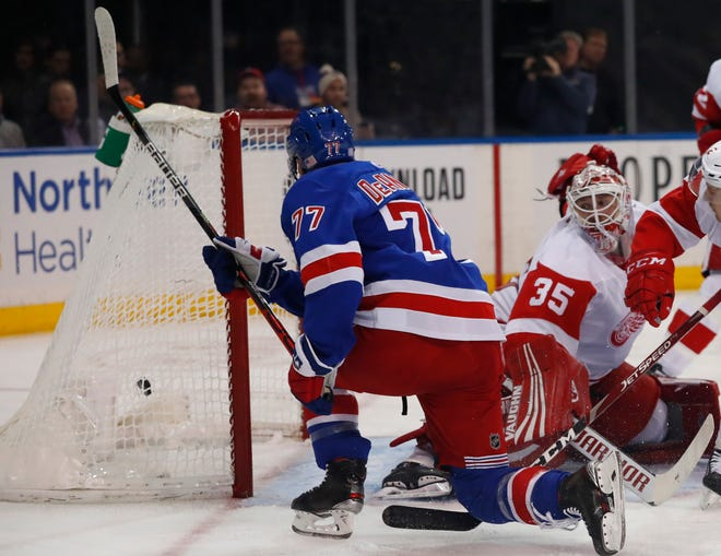 New York Rangers defenseman Tony DeAngelo (77) scores a goal against Detroit Red Wings goaltender Jimmy Howard (35) during the second period at Madison Square Garden.