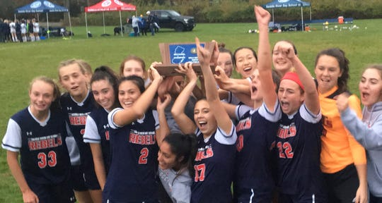 Members of the Saddle River Day girls soccer team celebrate their North, Non-Public B sectional title.