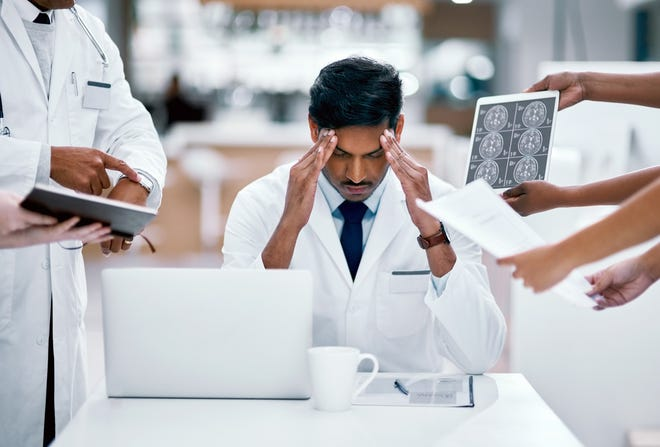 About half of doctors surveyed say they've felt symptoms of physician burnout.