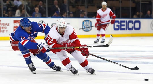 New York Rangers defenseman Marc Staal (18) defends against Detroit Red Wings center Andreas Athanasiou (72) during the first period at Madison Square Garden.