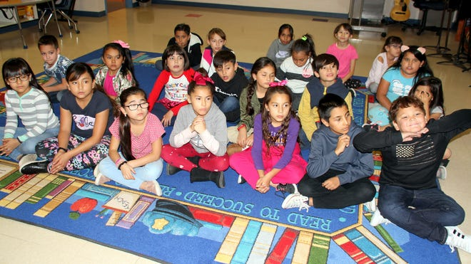 Third-grade students at Ruben S. Torres Elementary School rehearse on Wednesday for the Veterans Day program at 1 p.m. on Monday.