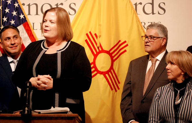 Elizabeth Groginsky, left, talks about her approach to leading New Mexico's newfound Early Childhood Education Department with the announcement Wednesday, Nov. 6, 2019, of her appointment as Cabinet secretary in Santa Fe, N.M. Gov. Michelle Lujan Grisham, right, helped create the agency this year and continues to lobby for greater state spending on early childhood education. Education experts worry that children in the state are falling behind in their development before reaching elementary school, with lifelong consequences.