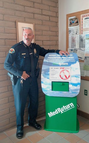 Bayard Chief of Police Lee Alirez with the MedReturn kiosk in the lobby of the Bayard Public Safety Building.