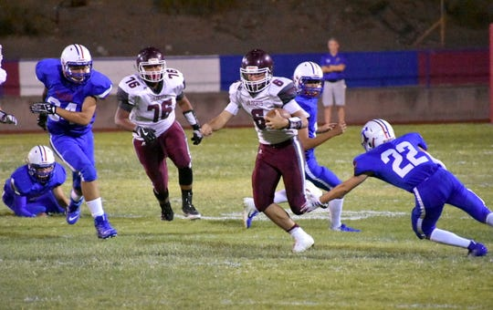 Tularosa quarterback Traiton Griffin scrambles against Hot Springs in the season-opener on Aug. 26, 2019. Griffin leads the Wildcats with 789 passing yards, 726 rushing yards and 20 total touchdowns.
