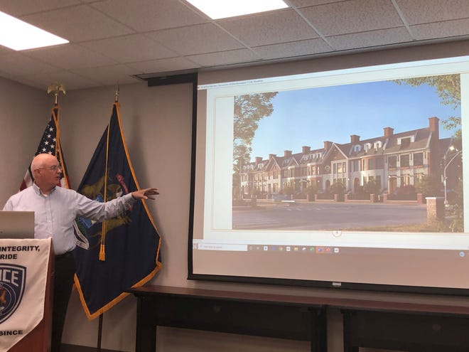 Ray LeDuc shows the Brownstones at Summit View of Milford, a smaller development than one previously denied as too large, to the Milford Village Council during their Nov. 4 meeting.