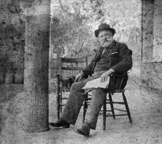 Austin Lacombe in later life, not long before he died, on the porch of the Old Lacombe Hotel on Court Street in downtown Opelousas.