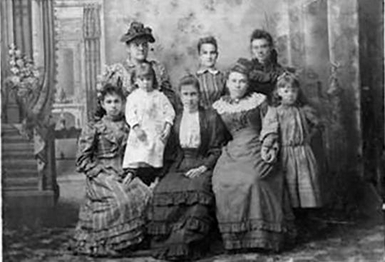 Photo of Mrs. Austin Lacombe and her daughters taken around the turn of the 20th century.