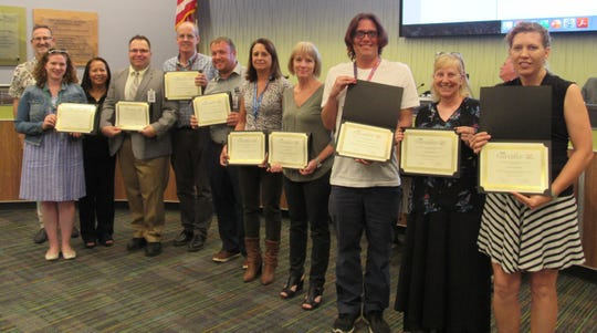 Palm Springs Unified School District Foundation Vice President Dan Spencer, left, presented classroom grants at a recent Board of Education meeting.
