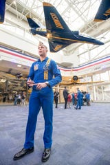 U.S. Marine Corps Maj. Jeff Mullins, the No. 4 pilot with the Blue Angels, talks Thursday about his experience flying with the team during an interview at the National Naval Aviation Museum in Pensacola.