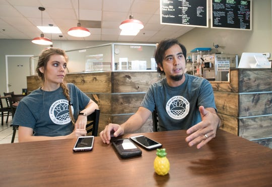 Owners Erin and Michael Perez talk about their food at Pineapple Express Rice Bowls in downtown Pensacola on Thursday.