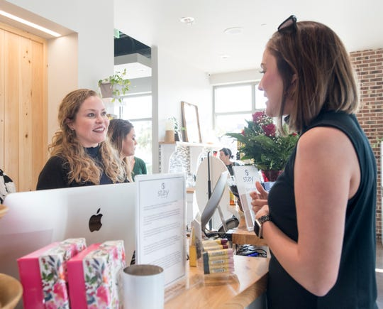 At left, Jennifer Walden Smith, owner of Stay The Spa, chats with Caitlyn Miller at the downtown Pensacola business on Nov. 6. Stay The Spa celebrated its one-year anniversary earlier this year.