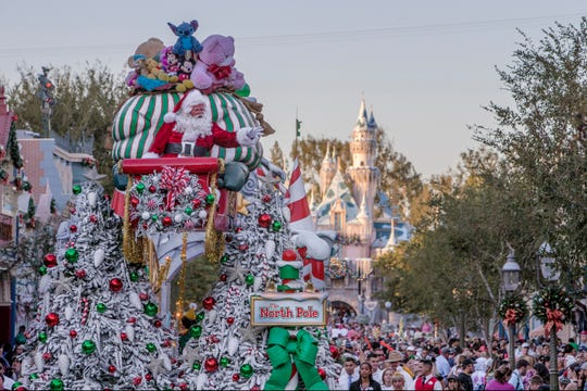 """Mickey, Minnie, Disney Princesses and Santa celebrate the season in """"A Christmas Fantasy"""" parade, a daily procession with floats, music and marching """"tin soldiers."""""""