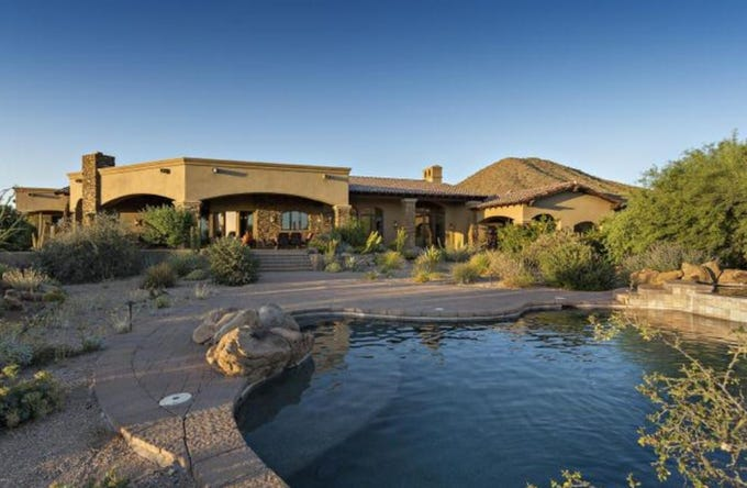 John and Camilla Clarke paid $2.93 million for this mansion in Scottsdale's Canyon Heights community.
