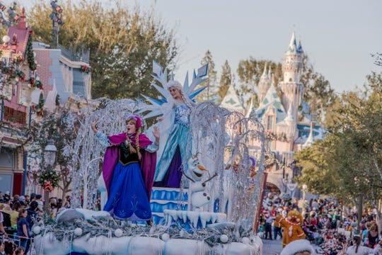"""Mickey, Minnie, Disney princesses and Santa celebrate the season in Disneyland's """"A Christmas Fantasy"""" parade, a daily procession with floats, music and marching """"tin soldiers."""""""