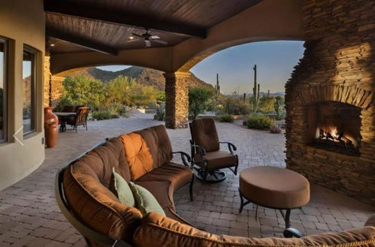 The $2.93M estate purchased by John and Camilla Clarke has a covered patio and panoramic Sonoran Desert views.