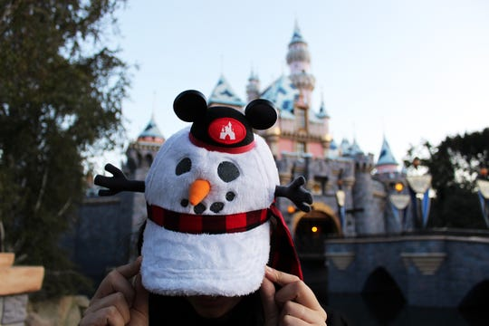 Guests will find plenty of themed merchandise during the holidays at Disneyland and Disney World. Enjoy the Light Up Snowman Ears.