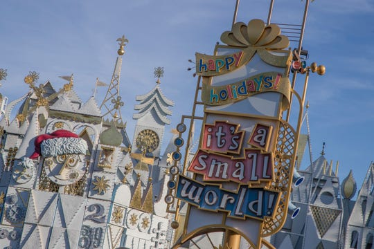 """Among the merriment at Disneyland Park, """"it's a small world"""" is transformed each evening into """"it's a small world"""" Holiday, with 50,000-plus colorful lights, music and video projections."""