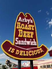 Sign expert Steve Skye spent a month refurbishing this neon 10-gallon hat Arby's sign in Phoenix.