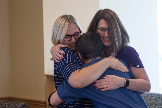 Ben Zaccardi hugs his mom, Cat Zaccardi (left), and Jennifer Hansen (right), his child life specialist, on Nov. 6, 2019.