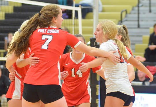 Port Huron celebrates scoring a point during the Division 1 volleyball district semifinal Wednesday, Nov. 6, 2019, at Macomb L'Anse Creuse North.