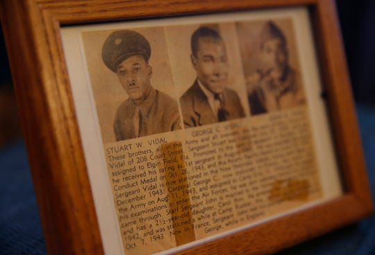 A framed newspaper clipping Stuart Vidal saved documenting his service in World War II, as well as that of his two brothers, photographed at his home in the Town of Poughkeepsie on November 7, 2019.