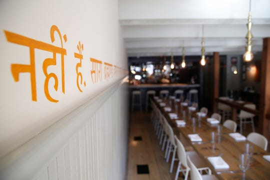 Hindi words adorn the walls of the dining room at Cinnamon in Rhinebeck on November 6, 2019.