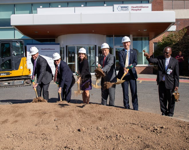 From left: Ulster County Executive Patrick Ryan, HealthAlliance board Chairman Thomas Collins, state Lt. Gov. Kathy Hochul, WMCHealth President and Chief Executive Officer Michael Israel and Kingston Mayor Steve Noble ceremonially break ground for the new HealthAlliance Hospital on Mary's Avenue in Kingston, N.Y., while the Rev. Louis Yaya sprinkles holy water as a spiritual cleansing.