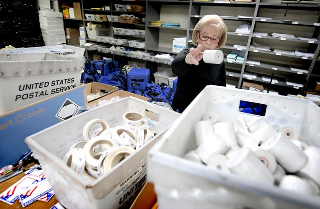 Temporary county worker Doris Feeser sorts and stores items returned from polling sites at the Elections and Voters Office at the York County Administration Building Thursday, November 7, 2019. The final vote tally was released earlier that morning after glitches with the new voting procedure on Tuesday delayed the count. Bill Kalina photo