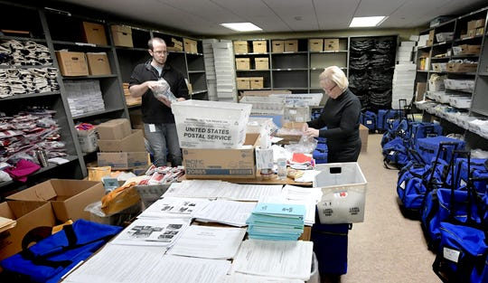 Temporary county workers Derek Kennell and Doris Feeser sort and store items returned from polling sites at the Elections and Voters Office at the York County Administration Building Thursday, November 7, 2019. The final vote tally was released earlier that morning after glitches with the new voting procedure on Tuesday delayed the count. Bill Kalina photo