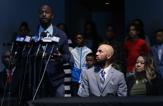 Marcus Riley, one of the men who was at Buffalo Wild Wings of Naperville on the night of the alleged racist incident, speaks about incident during a press conference at St. John African Methodist Episcopal Church in Aurora, Tuesday, Nov. 5, 2019. At right is Justin Vahl who was also at the restaurant. (Antonio Perez/ Chicago Tribune/TNS)