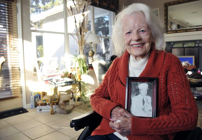 Doris Howard, 99, with a portrait of herself from her days as a U.S. Army nurse, sits in her south Reno home on Tuesday, Nov. 5.