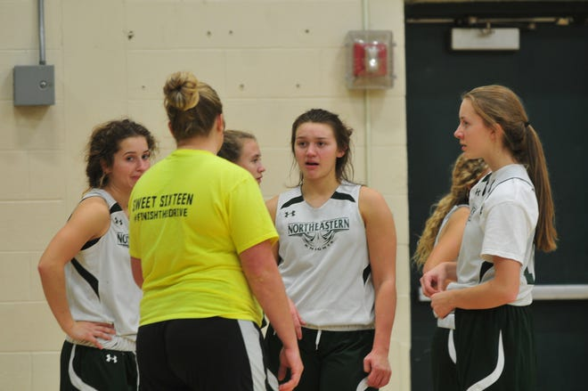 Northeastern head coach Sara Mayo (yellow) talks with her three team captains, Willow Runyon (left), Jenna McFarland (center) and Kelli Drake (right), during a practice on Wednesday, Nov. 6, 2019.