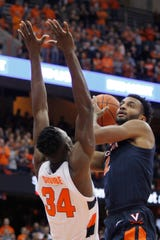 Virginia's Braxton Key, right, shoots over Syracuse's Bourama Sidibe, left, during the first half of an NCAA college basketball game in Syracuse, N.Y., Wednesday, Nov. 6, 2019.