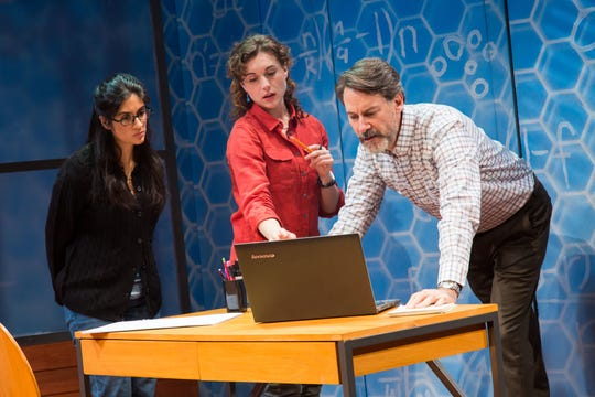 "Nikhaar Kishnani as Sanam, Marina Shay as Ariel and Ezra Barnes as their academic adviser, Philip Hayes, in Geva's production of ""Queen,"" find the numbers on a bee colony collapse disorder study don't add up."