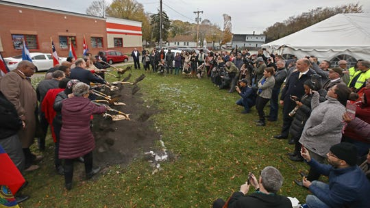 Dirt is sent flying as Rochester Mayor Lovely Warren is joined by dignitaries and guests for the official groundbreaking during ceremonies for La Marketa community plaza on the lot at 828 N. Clinton Ave. in Rochester Thursday, Nov. 7, 2019.
