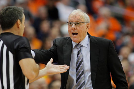 Syracuse head coach Jim Boeheim, right, yells at an official during the second half of Wednesday's loss to Virginia.