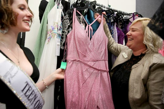 """Mikayla Wood, 17, of Scio, looks through dresses with Kara Richards, the owner of Shabby Chic Bride at Shabby Chic Bride consignment shop in Salem on Nov. 6, 2019. Wood is accepting donations now for the """"Be-You-tiful"""" Prom Dress Giveaway that will be held April 4, 2020. She is organizing the free event for any high schooler in Oregon and partnering with local dress shops."""