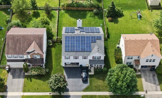 An aerial photo taken with a drone shows solar panels installed on a private home in Round Lake Heights, Illinois, September 2019.
