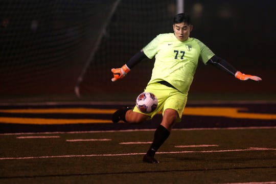 Stayton's goalkeeper Ivan Pelayo, 77, kicks a ball back into play during the Stayton vs Molalla boys soccer game on Nov. 6, at Stayton High School. During the first round of the state playoffs, Stayton defeated Molalla, 8-1.