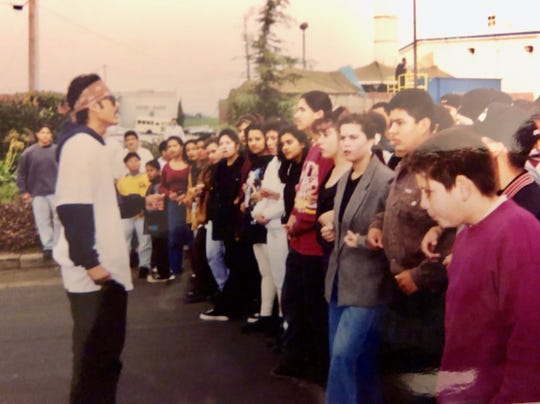 Photo of a student walk-out in protest of Proposition 187 Luis Alejo helped to organize. 1994.