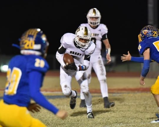 Brady High School's J.D. Ibarra looks for running room in a District 13-3A Division II football game Nov. 1, 2019, in Comfort.