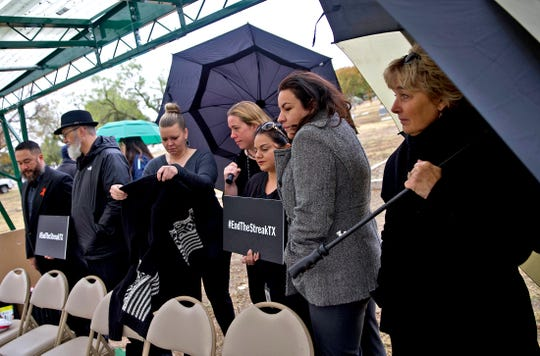 People participate in an event marking the last day free of a fatality on Texas roadways on Thursday, Nov. 7, 2019 at Fairmount Cemetery in San Angelo.
