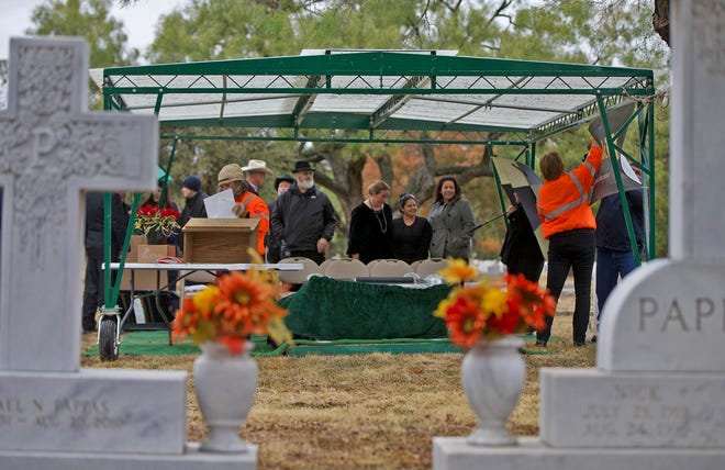 People gather under a tent at Fairmount Cemetery on Thursday, Nov. 7, 2019 for an event held by the Texas Department of Transportation marking the anniversary of the last deathless day on Texas roads.