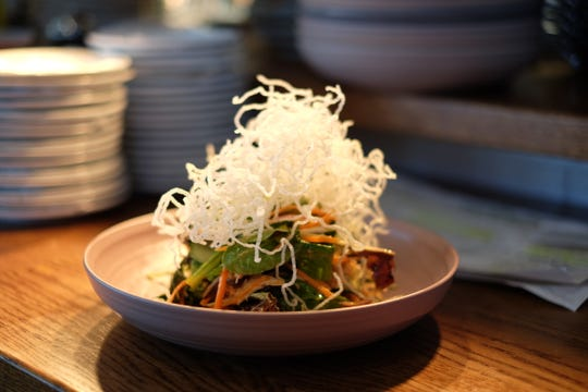 A taste of Thompson Island Brewing Company in Rehoboth Beach has to offer: a Thai chicken bowl with peanut dressing and crispy rice noodles. Wednesday, Nov. 6, 2019.