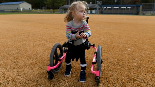 "Emerson ""Emme"" Thomas, 3, stands in her gait trainer on Field 7 at the Henry S. Parker Athletic Complex in Salisbury, on Tuesday, Nov. 5, 2019. Emme lives with disabilities that keep her from walking on her own, and her family looks forward to the possibility of the Field 7.5 project."