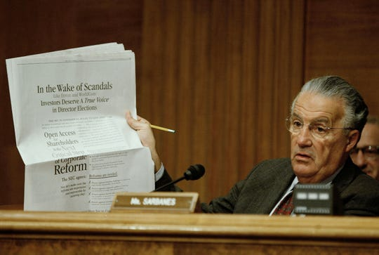 U.S. Sen. Paul Sarbanes, D-Md., holds up a news paper while hearing testimony from William Donaldson, Chairman of the Securities and Exchange Commission testifies during Senate Banking, Housing and Urban Affairs Committee hearing on Capitol Hill September 30, 2003, in Washington, DC. The committee is hearing testimony on the state of the securities industry.