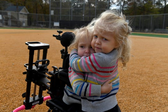 Twin sisters Emerson (left) and Elle, 3, embrace on Field 7 the Henry S. Parker Athletic Complex in Salisbury, on Tuesday, Nov. 5, 2019.