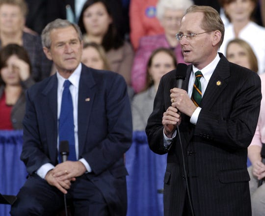 -  Former Congressman Jim McCrery introduces President George W. Bush during a town hall meeting to discuss Social Security reform at Centenary College's Gold Dome in 2005.